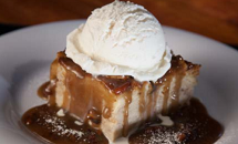 Housemade Bread Pudding with Praline Sauce